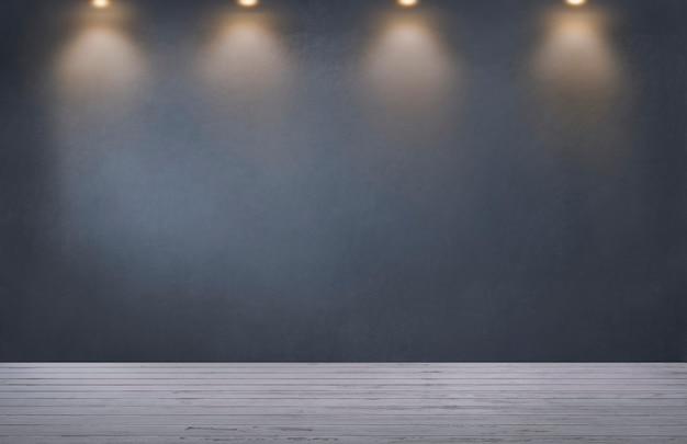 Parete grigio scuro con una fila di faretti in una stanza vuota Foto Gratuite