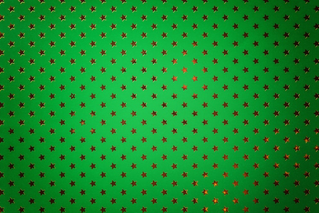 Dark green background from metal foil paper with a golden stars Premium Photo