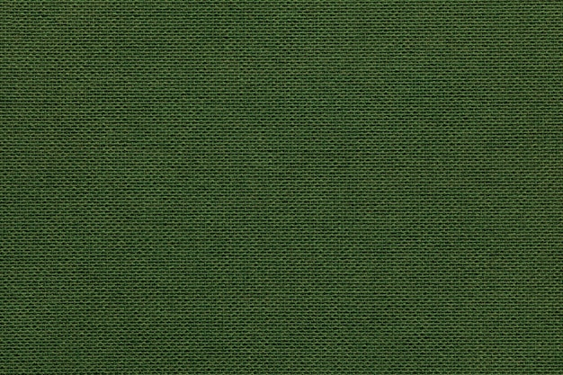 Dark green background from a textile material with wicker Premium Photo