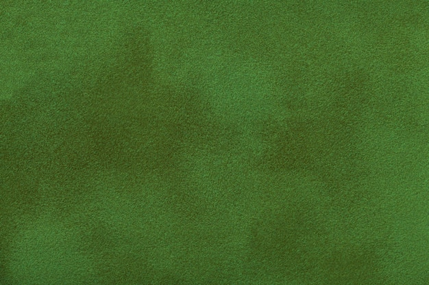 Dark green matte background of suede fabric, closeup. Premium Photo
