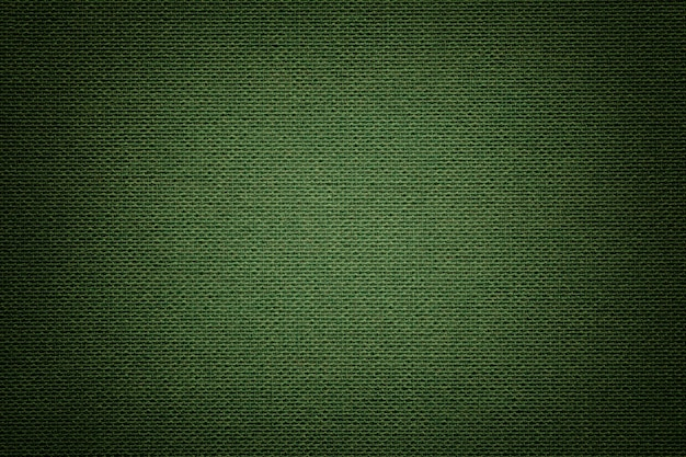 Dark green a textile material, fabric with natural texture. Premium Photo