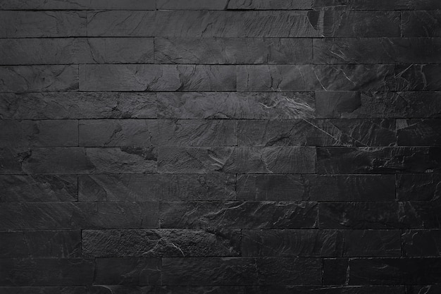 Dark grey black slate texture in natural pattern with high resolution for background and design art work. black stone wall. Premium Photo