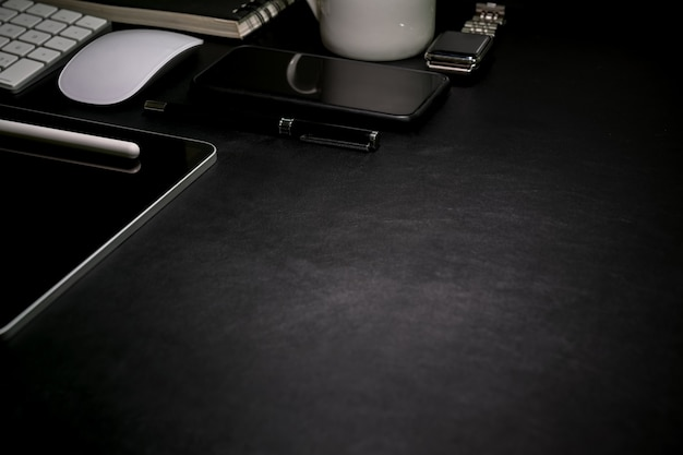 Dark leather desk top table with office supplies and copy space Premium Photo
