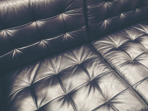 Dark leather texture background with buttoned pattern Premium Photo