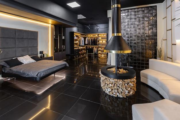 Premium Photo Dark Modern Stylish Male Apartment Interior With Lighting Decorative Walls Fireplace Dressing Area And Huge Window