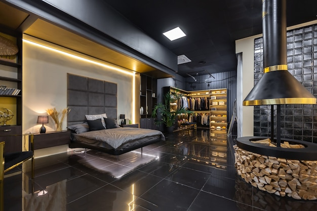 Dark modern stylish male apartment interior with lighting, decorative walls, fireplace, dressing area and huge window Premium Photo