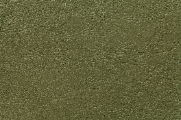 Dark olive leather texture background, closeup. green cracked backdrop Premium Photo