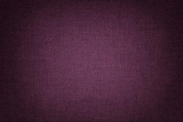 Темно-фиолетовый фон из текстильного материала с плетеным узором Premium Фотографии