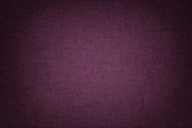 Dark purple background from a textile material with wicker pattern Premium Photo