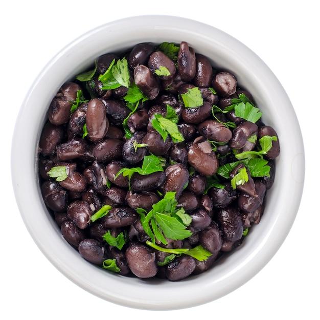 白いボウルに濃い赤の缶詰の豆。スタジオ写真 Premium写真