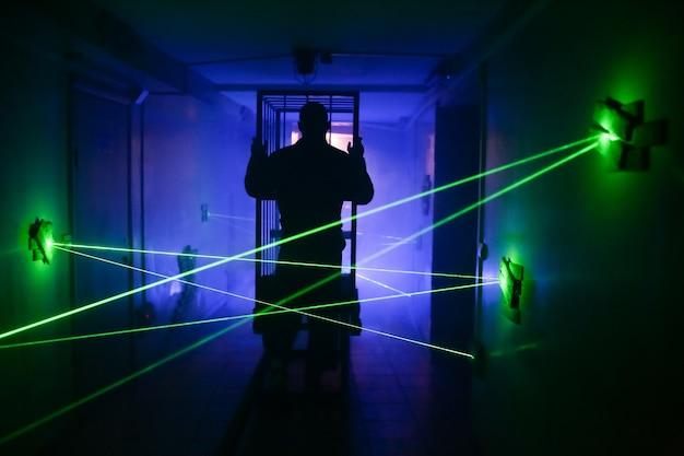 Dark room laser light effect cart silhouette Premium Photo