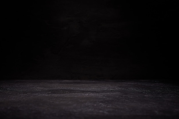 Темная комната с полом гранж фон Premium Фотографии
