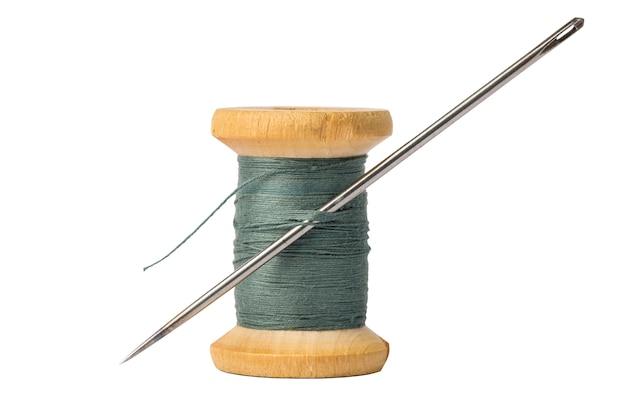 Dark thread spool and big needle isolated on white Premium Photo