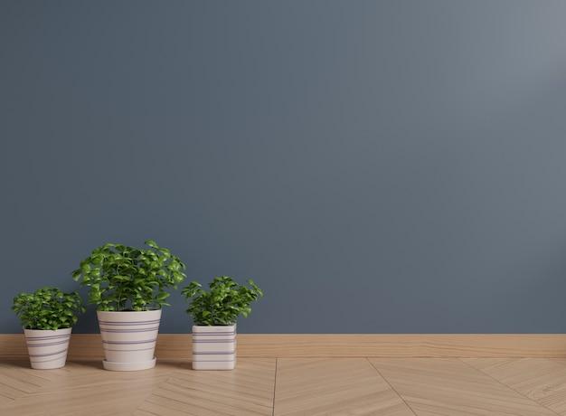 바닥에 식물을 가진 어두운 벽 프리미엄 사진