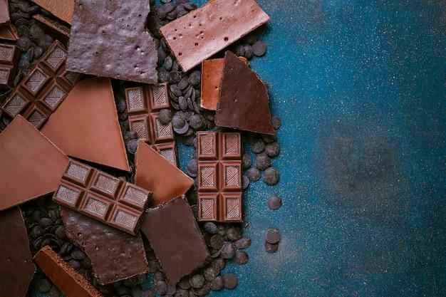 Dark, white and milk chocolate pieces. top view Premium Photo