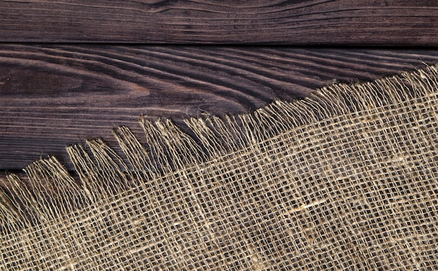 Dark wood with old burlap texture, top view Free Photo