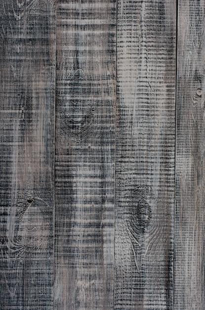 Dark wooden background made of a wide board, painted in dark brown . Premium Photo