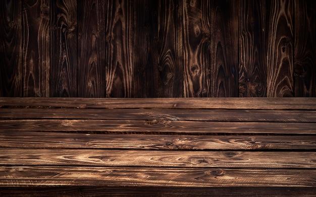 Dark wooden table background Premium Photo