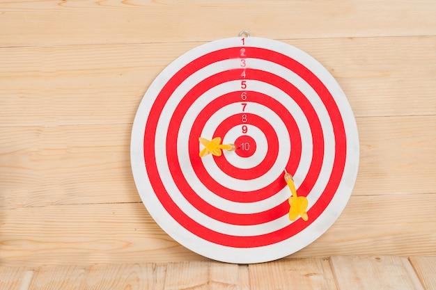 Dart arrow hitting in bullseye on dartboard with money Premium Photo