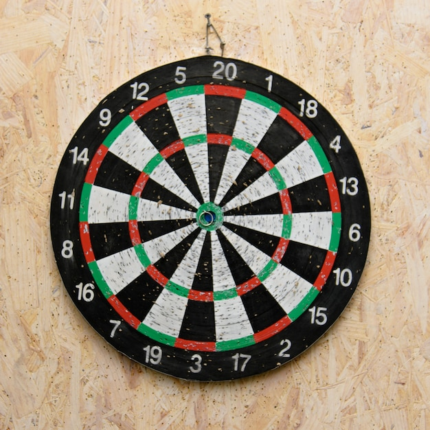 Dart arrow hitting in the target center of dartboard Premium Photo