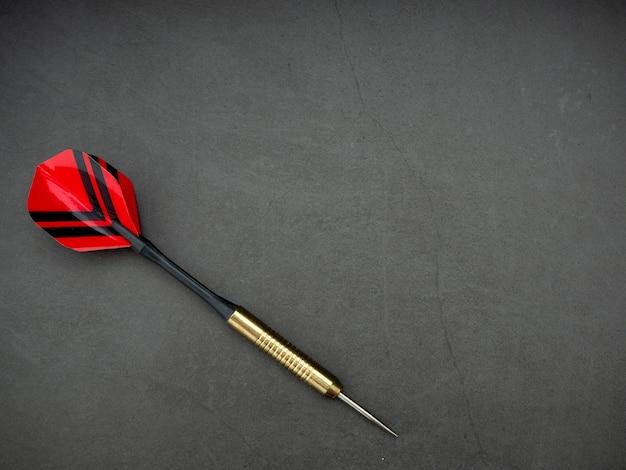 Dart arrow with board on black granite Premium Photo
