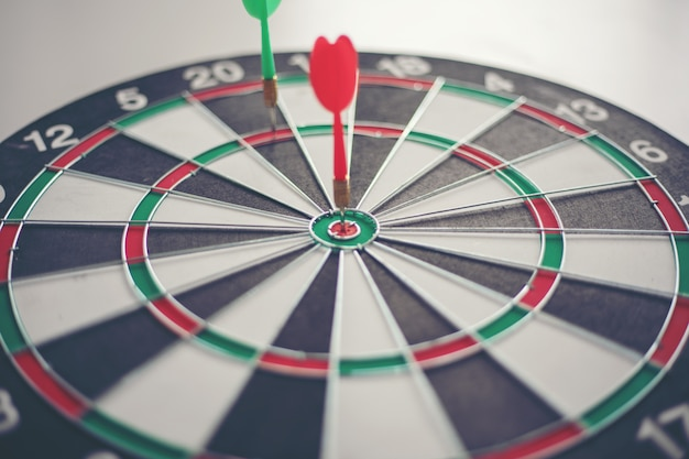 Dart hits bullseye is a target and goal of business marketing as concept. Premium Photo