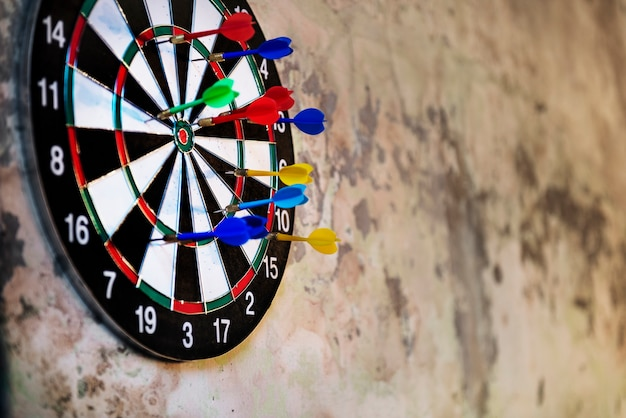 Dartboard arrows hit target game activity Free Photo