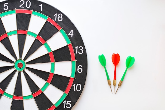 Dartboard and darts Premium Photo