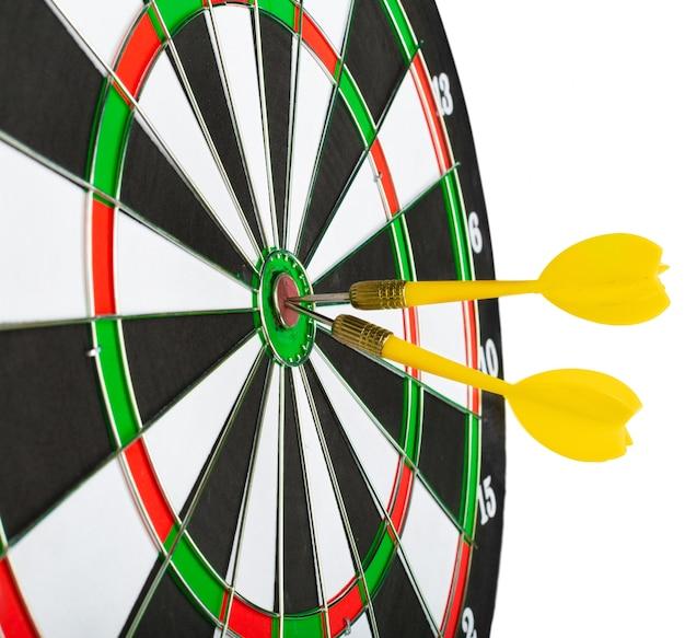 Dartboard with darts Premium Photo