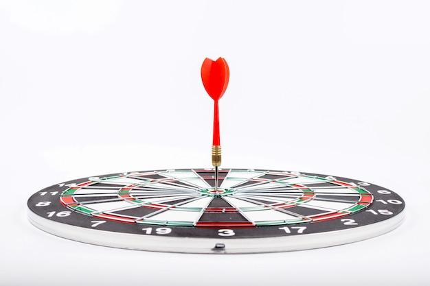 Dartboard with red dart arrow Premium Photo