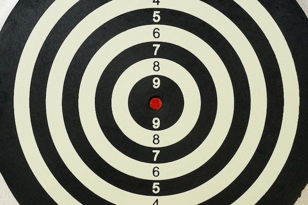 Dartboard with red target point in the center Premium Photo