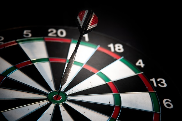 Darts arrows in center target. many attempts to succeed concept Premium Photo