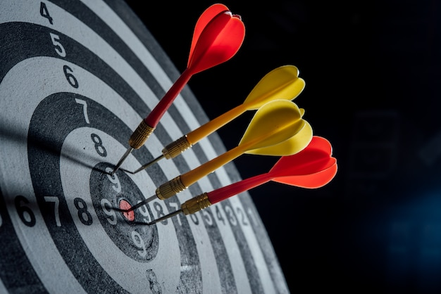 Darts arrows in the target center business concept Free Photo