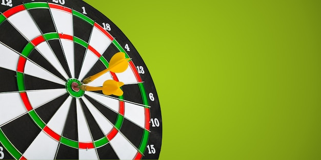 Darts arrows in the target center Premium Photo