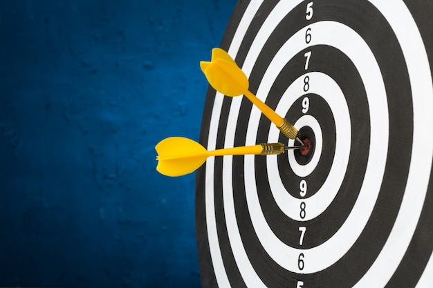 Darts arrows in the target center Premium Photo