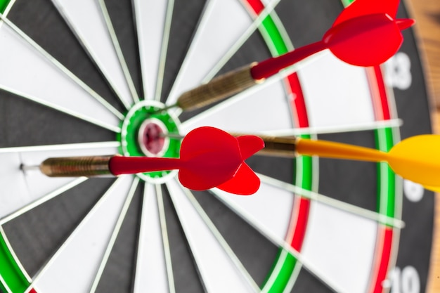 Darts nailed on target, close-up Premium Photo