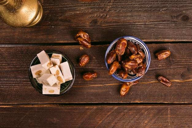 Dates fruit in bowl with turkish delight Free Photo