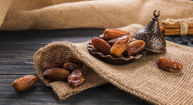 Dates fruit on plate on canvas Free Photo