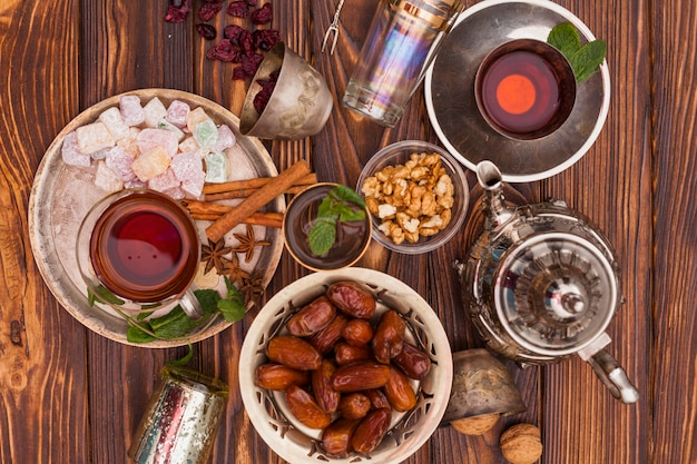 Dates fruit and turkish delight with tea Free Photo