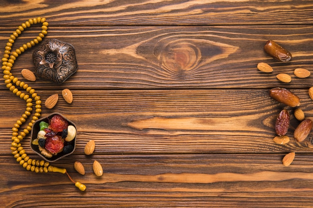 Dates fruit with nuts and beads Free Photo