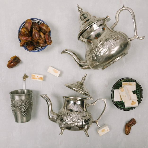 Dates fruit with turkish delight and teapots Free Photo