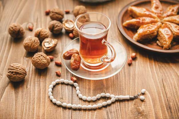 Dates, rosaries and baklava. ramadan. selective focus. Premium Photo