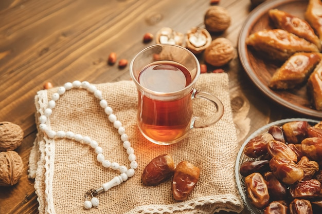Dates, rosaries and baklava. ramadan. selective focus. Premium Photo
