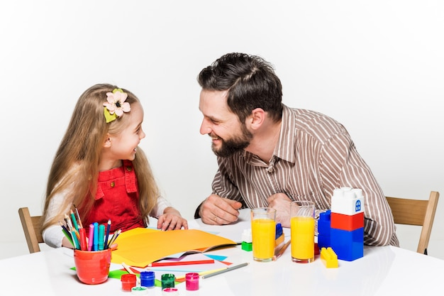 The daughter and father drawing together Free Photo