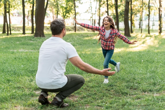Daughter and father having fun in beautiful nature Free Photo