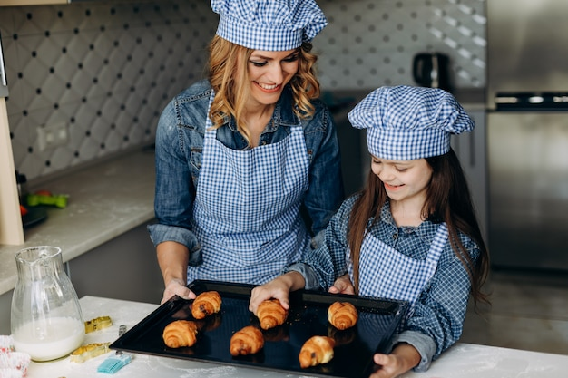 Daughter and mother baked croissants.family concept Premium Photo