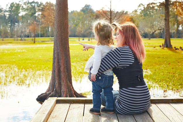 Daughter and mother playing together in park Premium Photo
