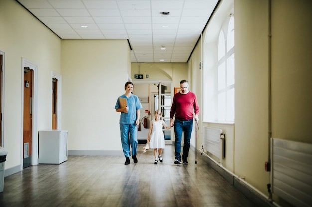 Daughter walking with her disabled father Premium Photo
