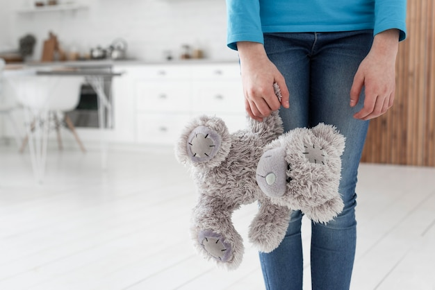 Daughter with teddy bear sad for family breakup Premium Photo