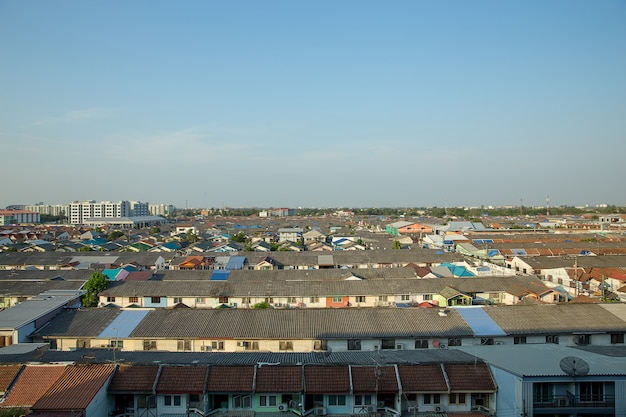 Day time of cityscape rooftop view of roof-tile houses in bangkok,clear sky Premium Photo